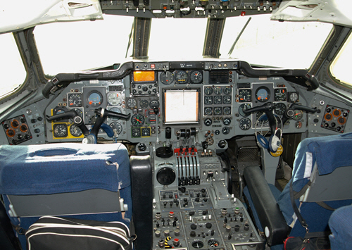 A very complicated looking flight deck of an aircraft.
