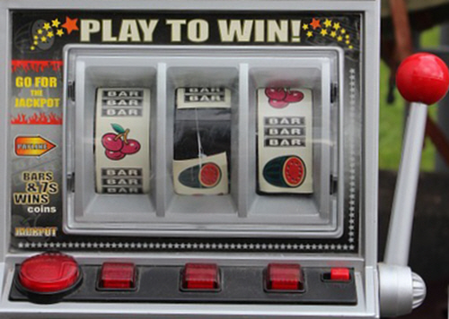 An old-fashioned one-arm-bandit fruit machine.
